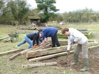 A raised bed being made from roof trusses